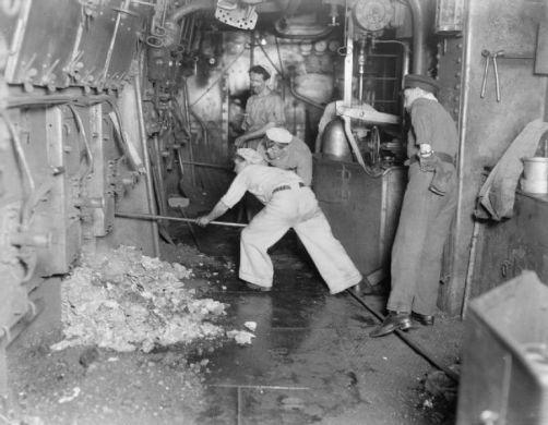 771px-Stokers_at_work_on_HMAS_Australia_IWM_Q_18773
